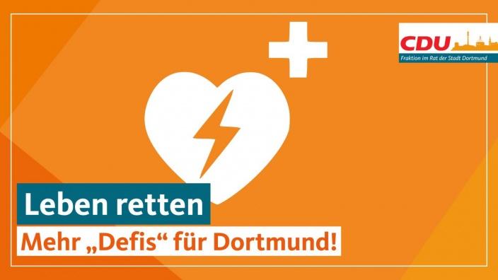"""Auf dem Bild sehen Sie den Schriftzug """"Leben retten: Mehr Defis für Dortmund"""" auf orangenem Grund."""